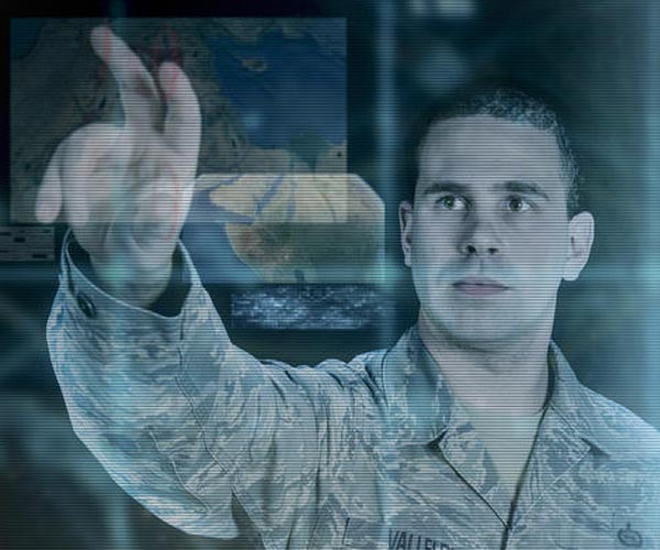 military-man-interacting-with-touch-screen-wall